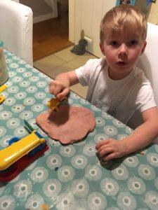 Oliver making pink playdough